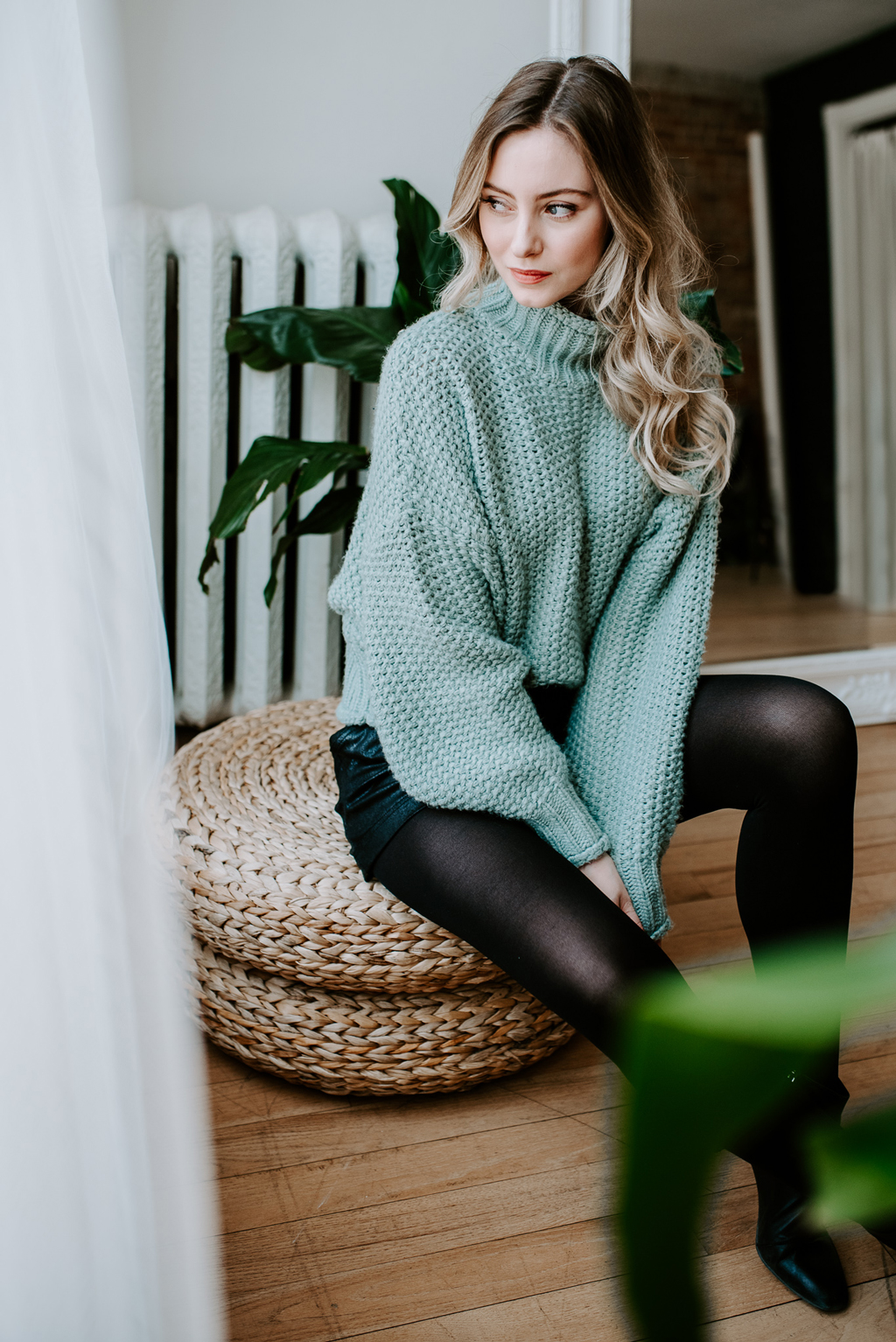 girl in cozy mint sweater